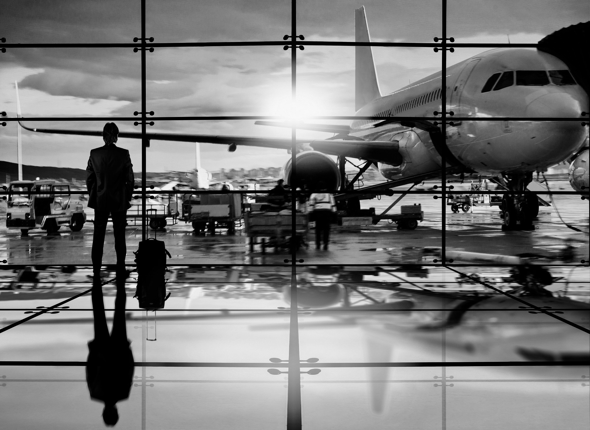 Business man waiting to board a flight in airport